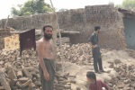 man with flood damaged house Charsadda Pakistan